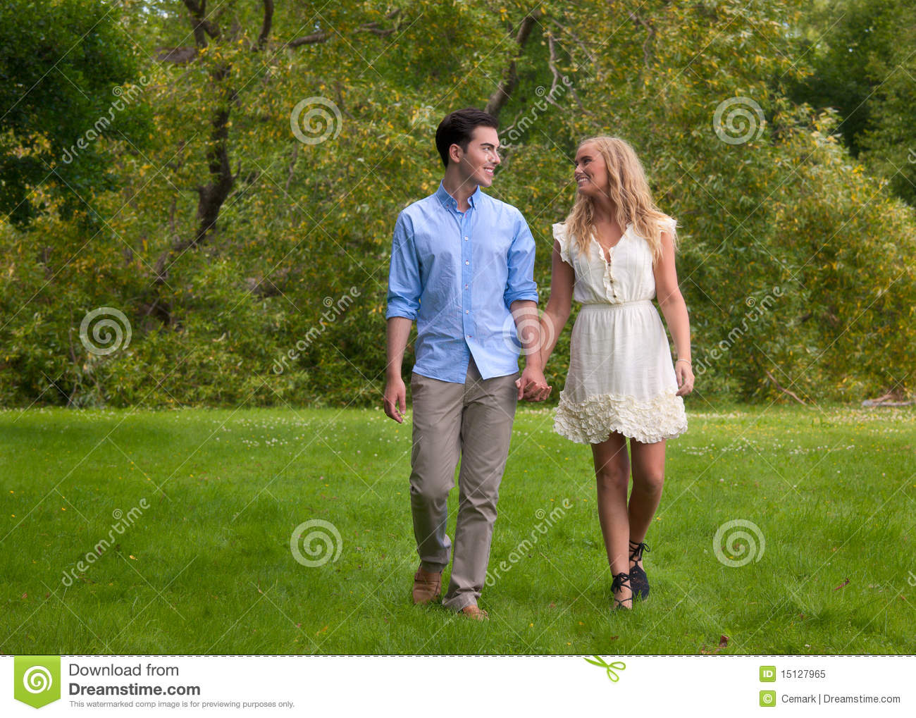 Royalty Free Stock Photo  Beautiful young couple walking in the parkYoung Couple Walking In The Park