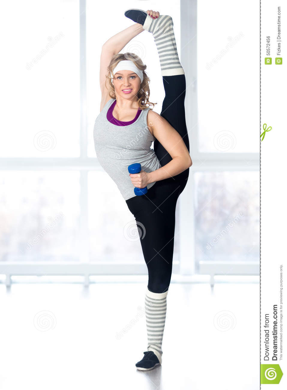 Beautiful Young Dancer Doing Stretching Exercises With ...
