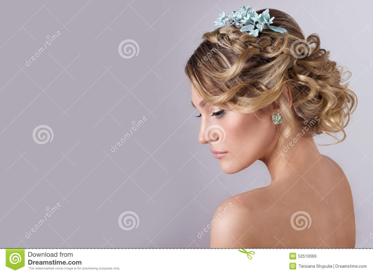 Beautiful young elegant sweet girl in the image of a bride with hair and flowers in her hair , delicate wedding makeup
