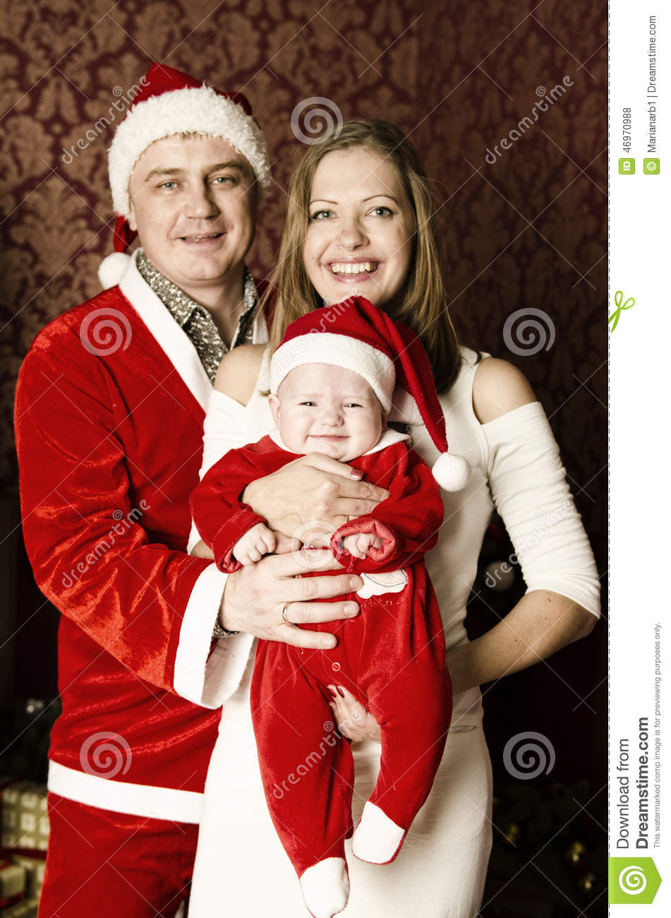 Beautiful Young Family With Little Cute Baby Girl On Christmas Stock