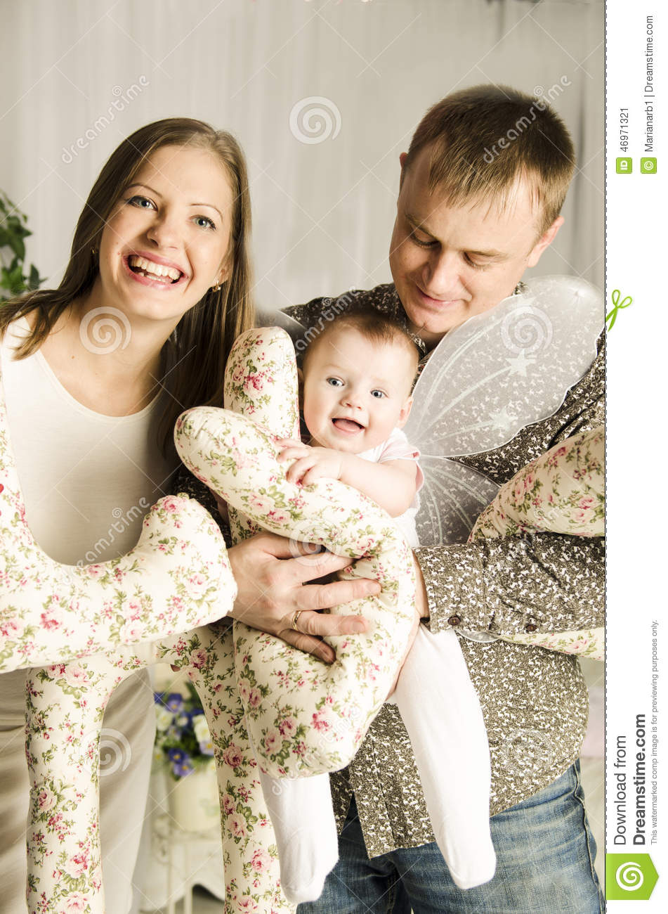 Beautiful Young Family With Little Cute Baby Girl Stock Image