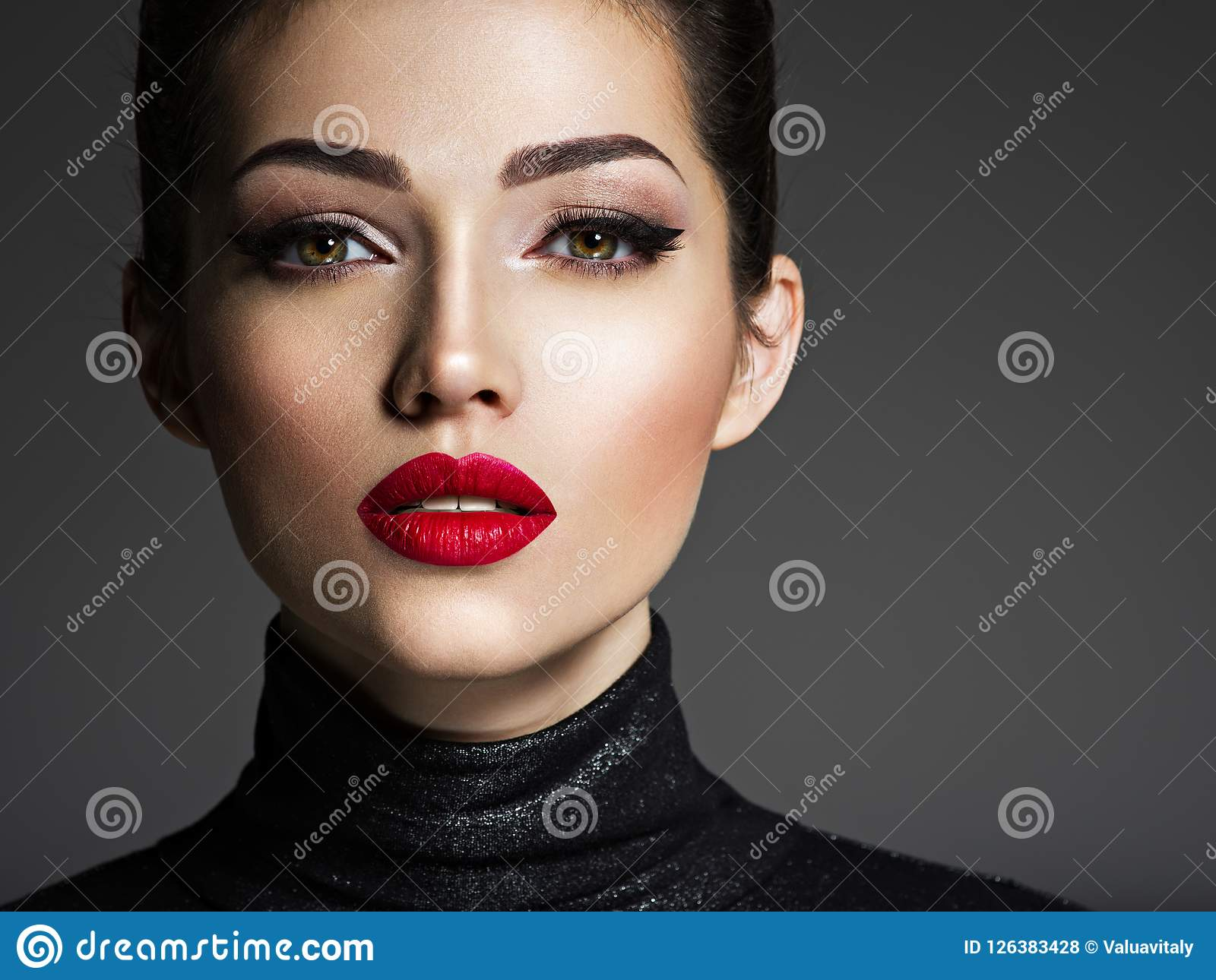 Beautiful young fashion woman with red lipstick.