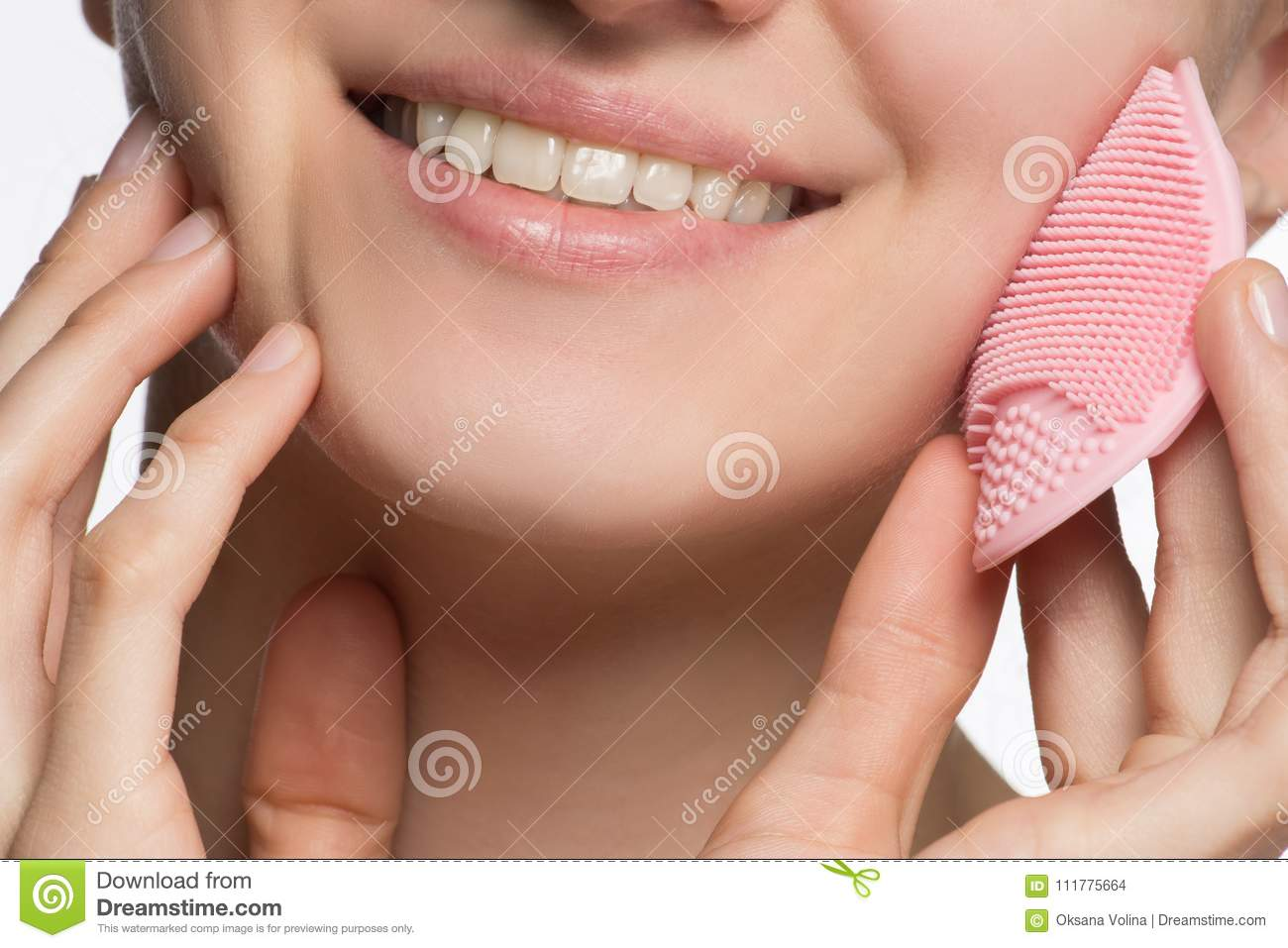 Beautiful young female model smiling and peeling face and nose w