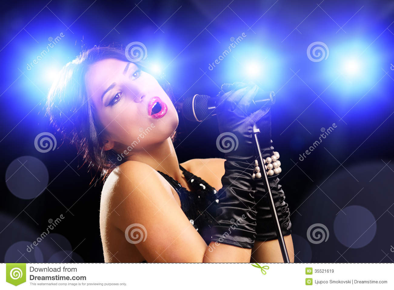 Beautiful Young Female Singer In Black Dress Singing ...