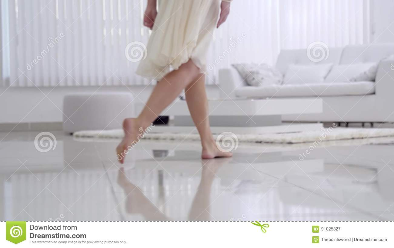 beautiful young girl bare feet moving on interior in the living room