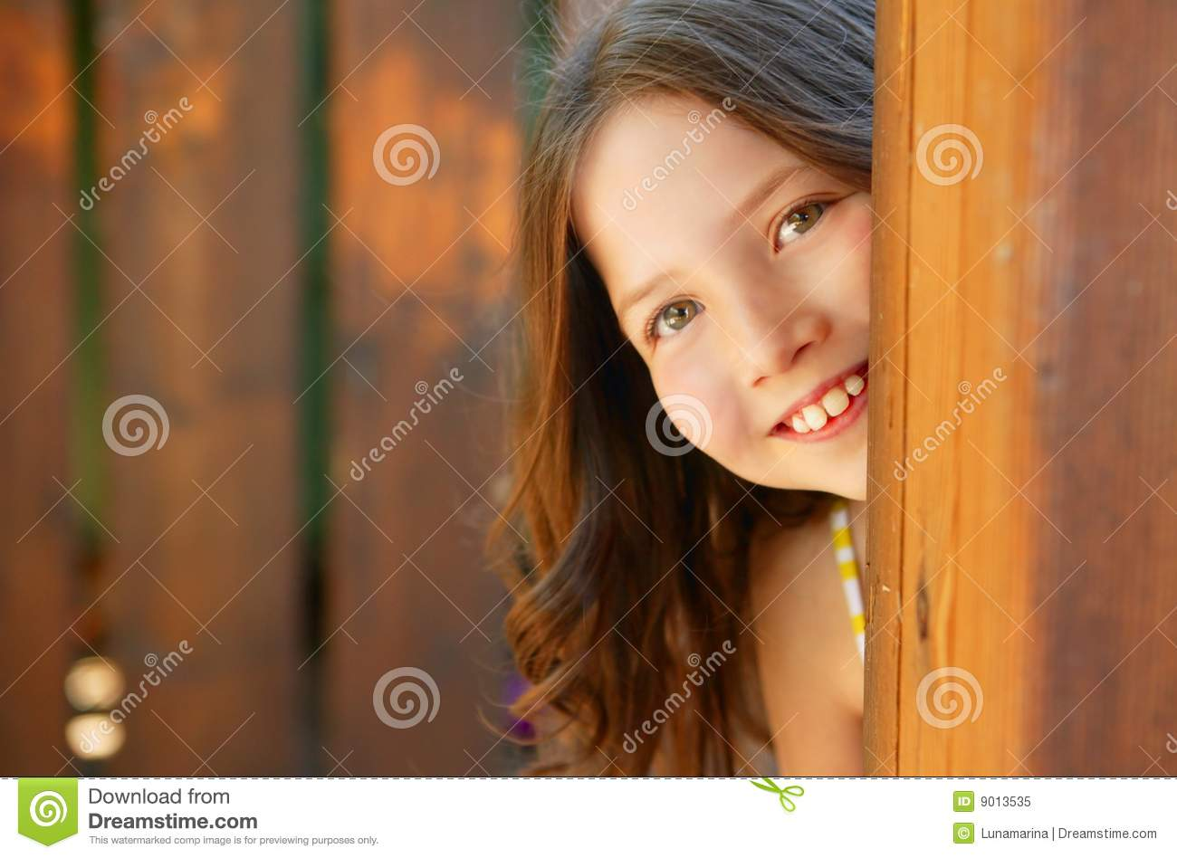 Beautiful Young Girl Behind The Wooden Door Royalty Free Stock Photo ...