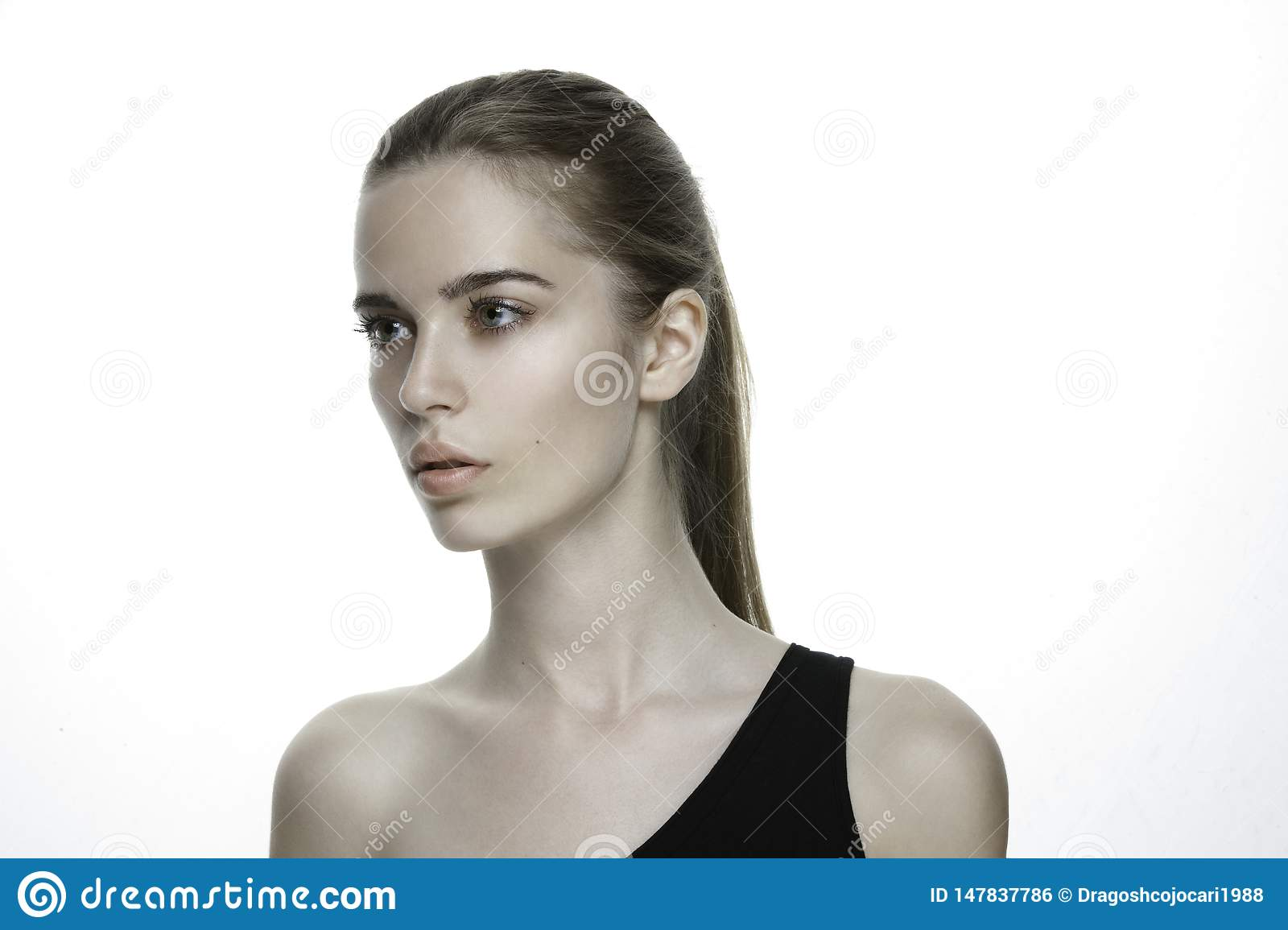 Beautiful young girl, clean soft skin care. Beauty Portrait. Perfect Fresh Skin. Youth and Skin Care Concept, pony tail.
