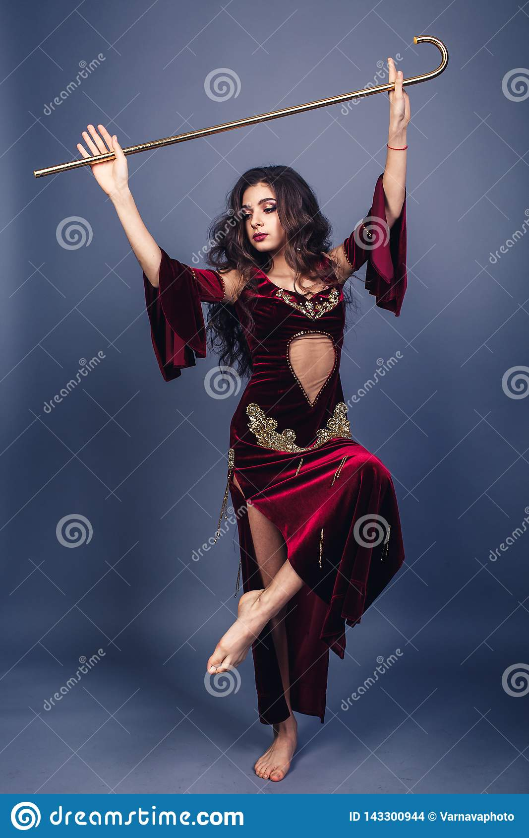 Portrait Of Young Belly Dancer In Golden Costume Stock