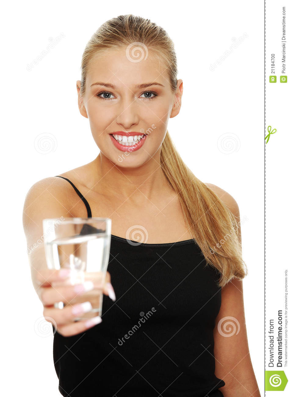 Beautiful young girl drinks water