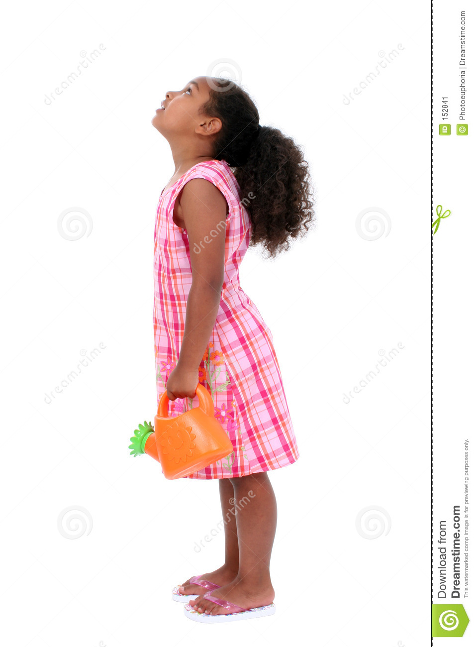 Beautiful Young Girl With Flower Watering Can Looking Up