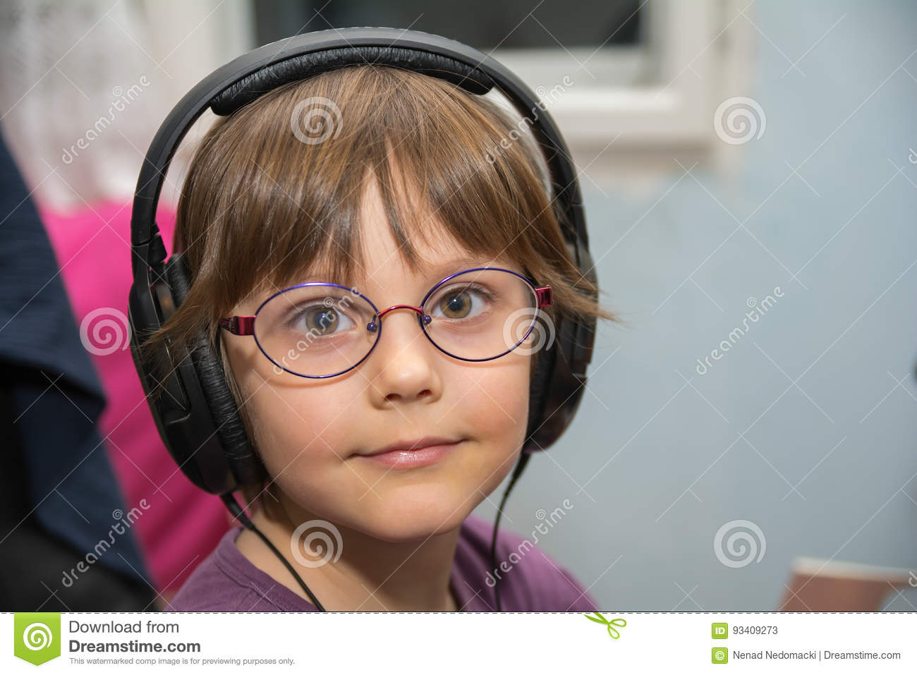 Beautiful young girl listening to music with headset