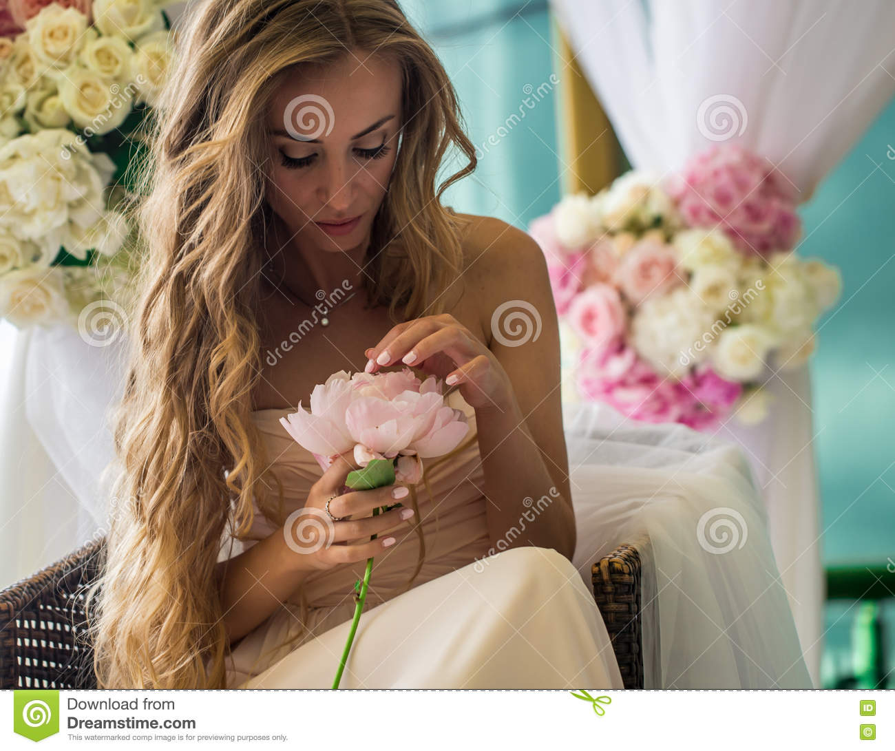Beautiful young girl with long hair flowers in hand stock photo beautiful young girl with long hair flowers in hand izmirmasajfo