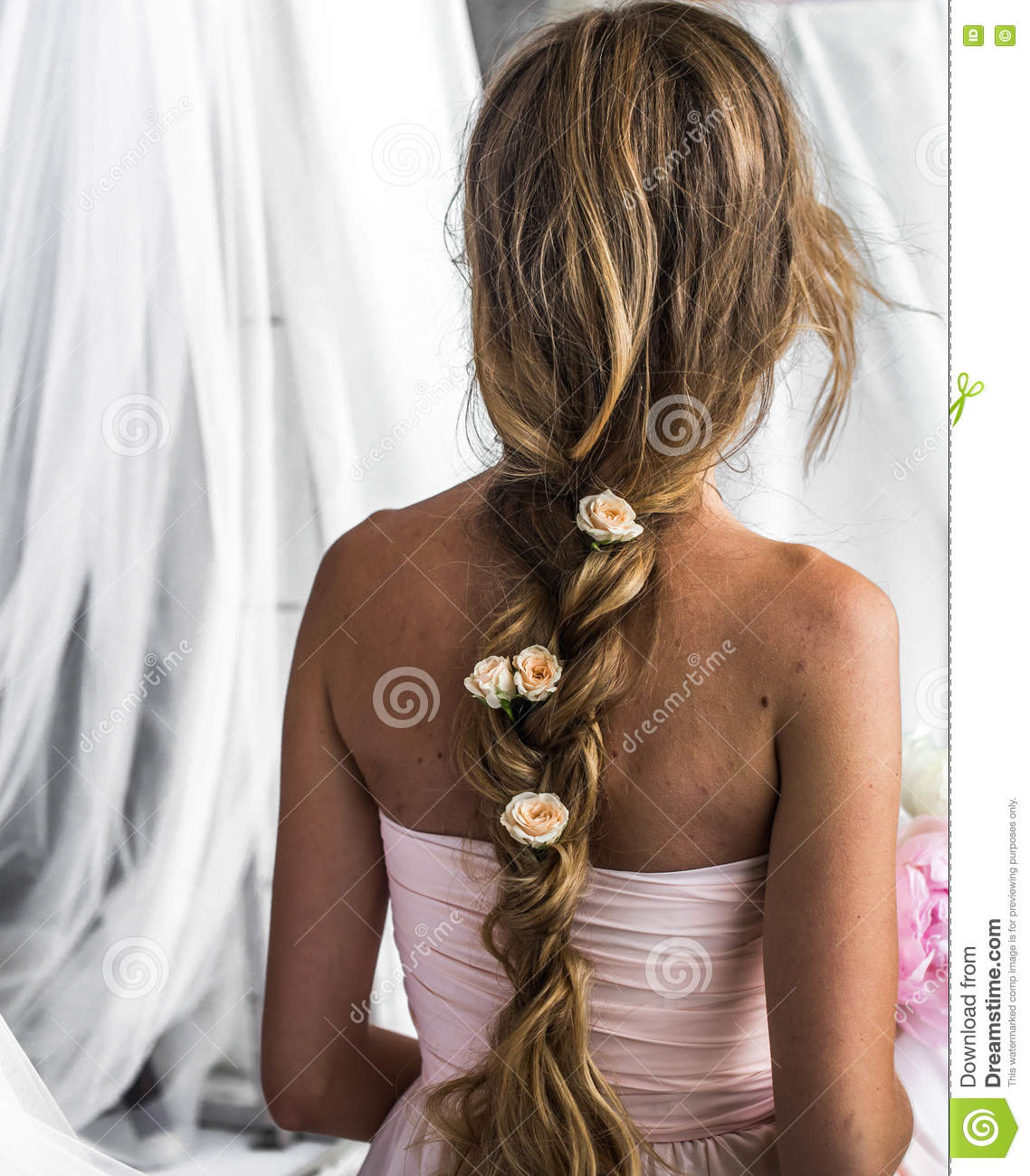 Beautiful young girl with long hair flowers the tenderness of the beautiful young girl with long hair flowers the tenderness of the mystery in a braid steed back izmirmasajfo