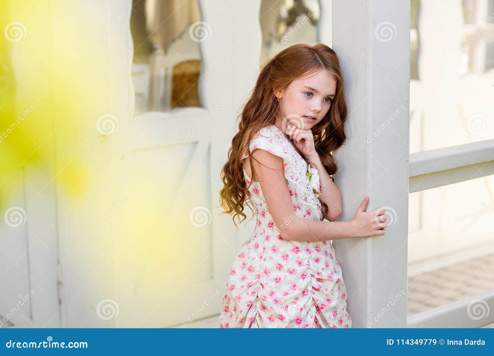 Beautiful young girl outdoors.