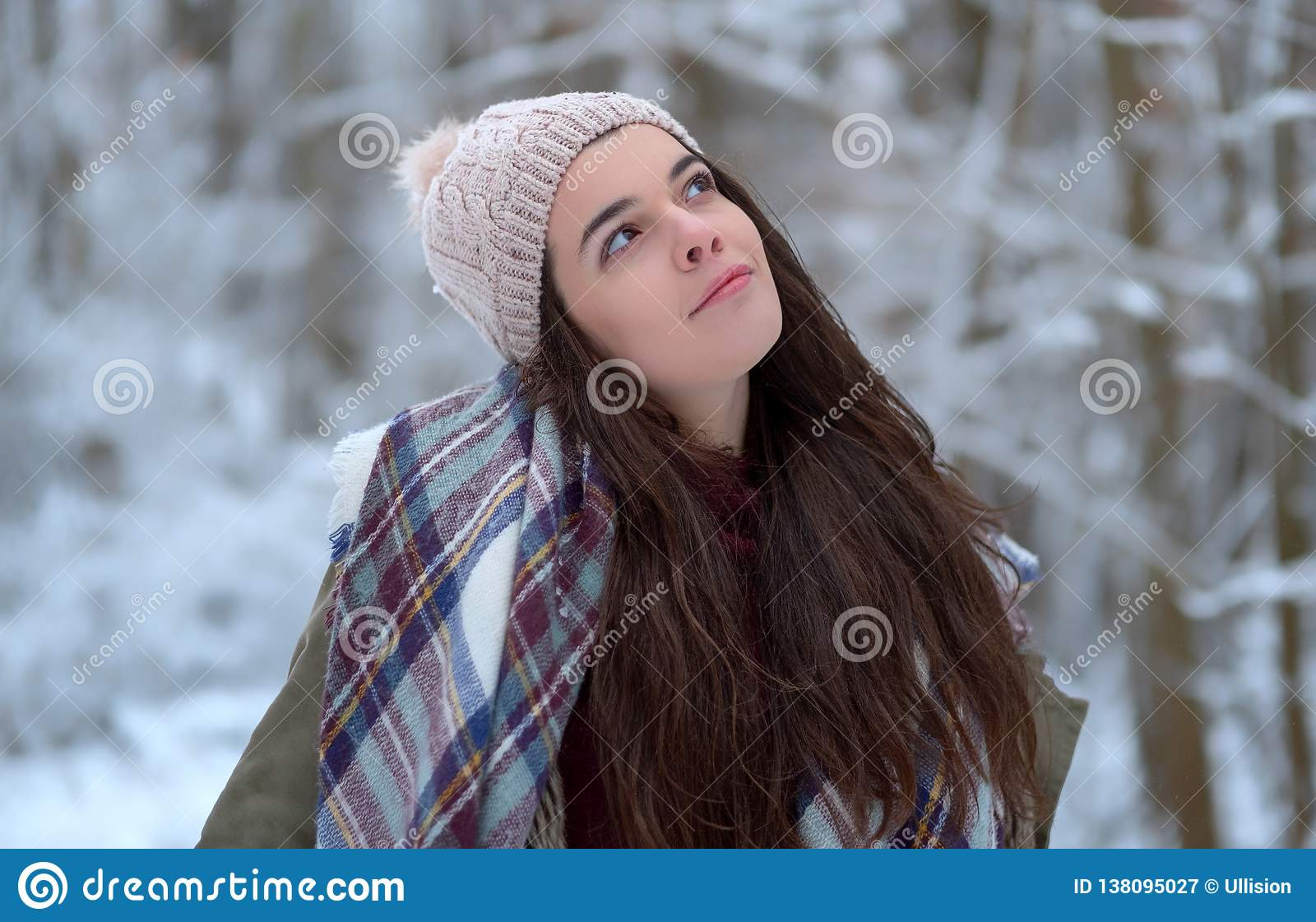 Beautiful young girl portrait with scarf, joyful model cold in winter park. Happy enjoying the nature