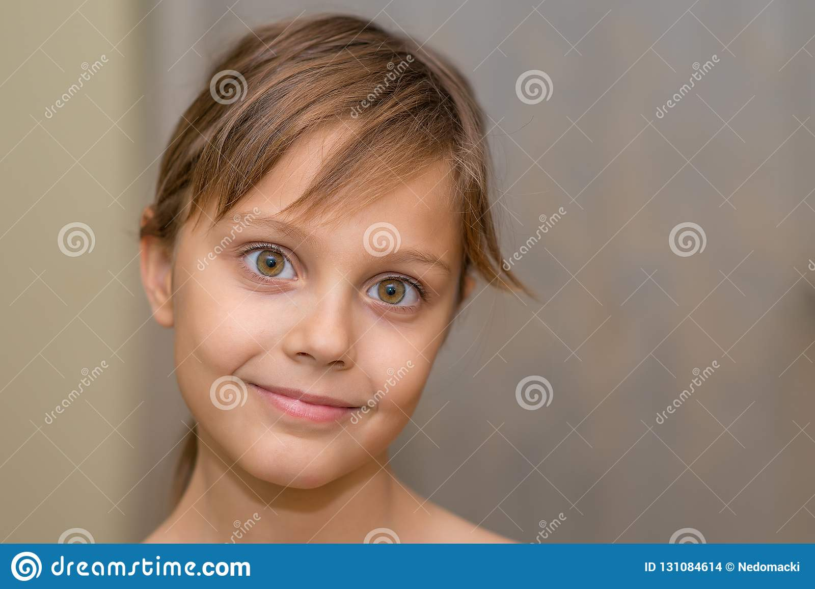 Beautiful young girl posing in front of the camera