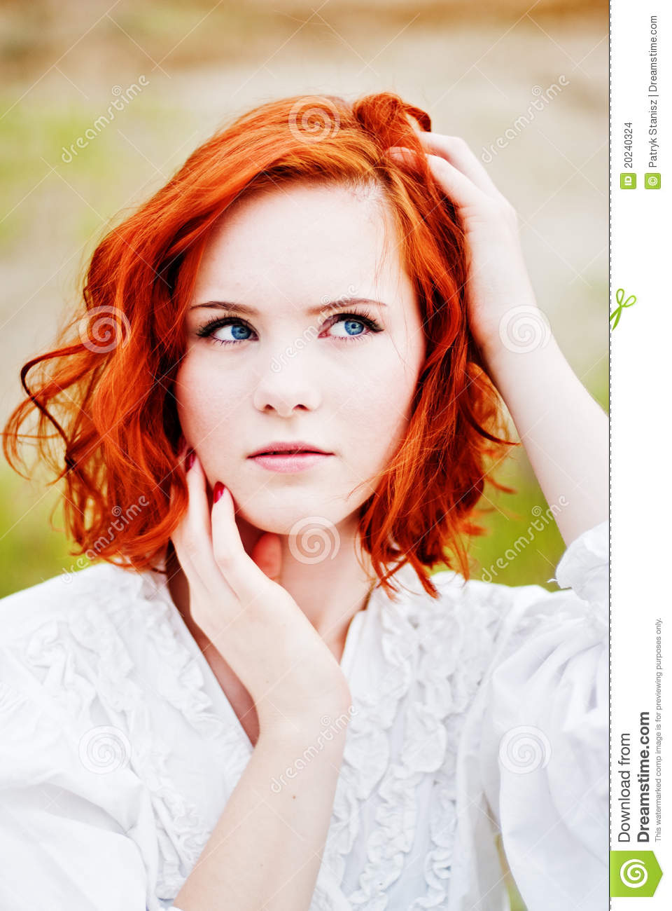 Young girl with red hair have removed
