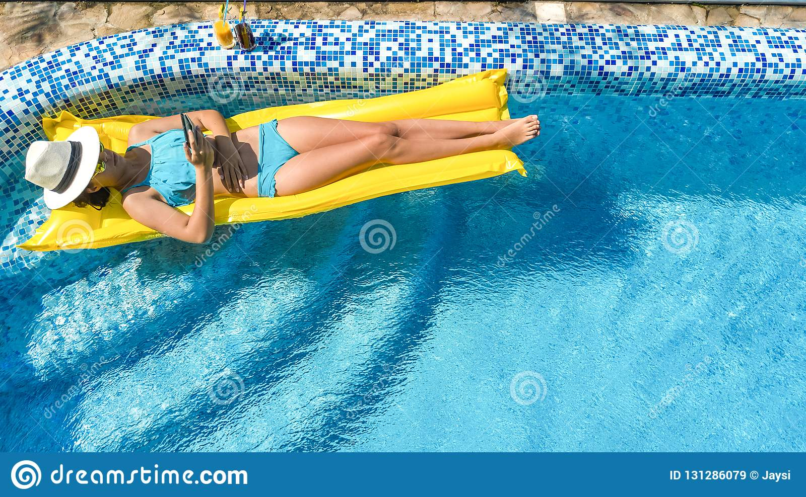 Beautiful young girl relaxing in swimming pool swims on - Swimming pool girl christmas vacation ...