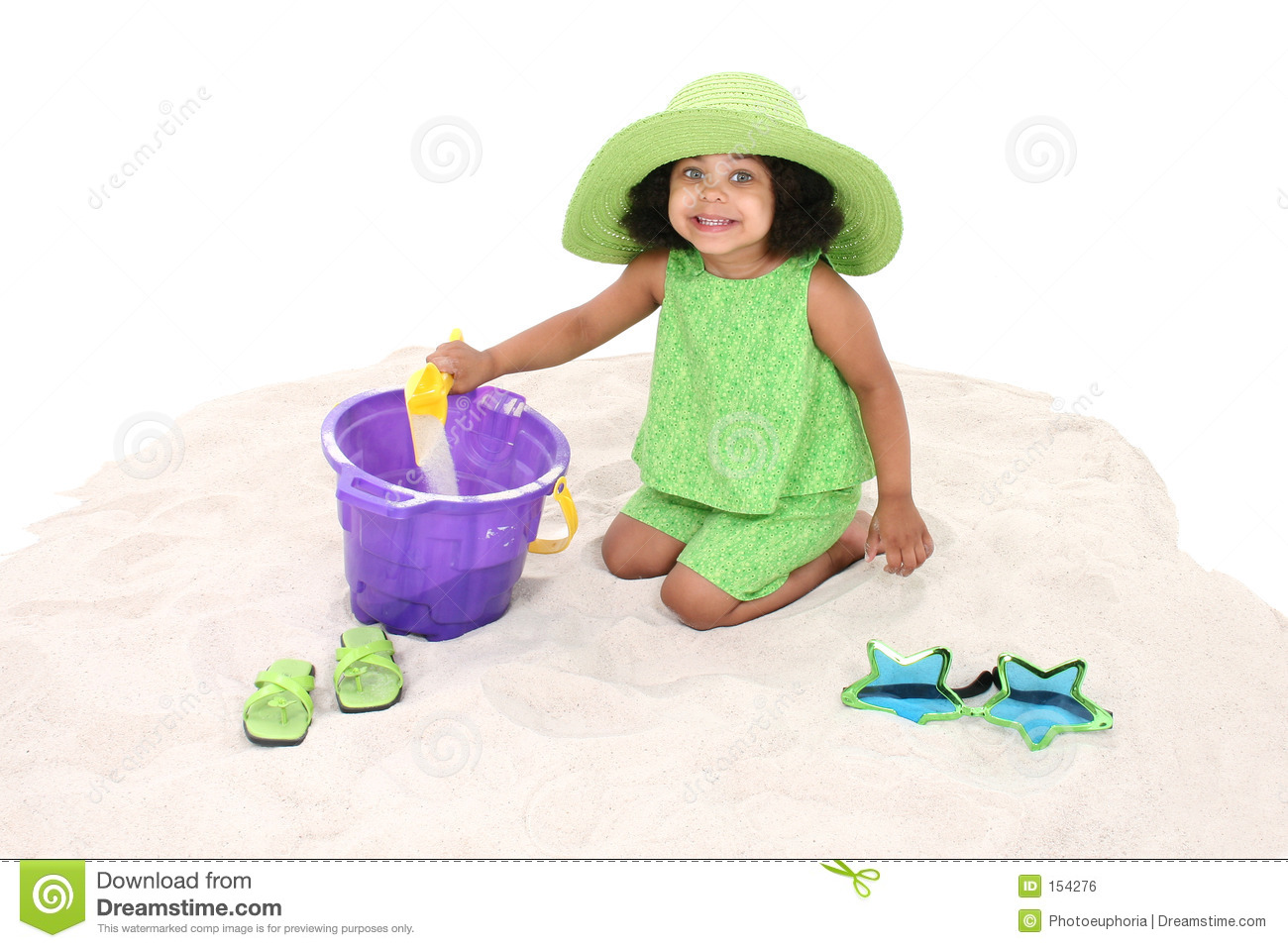 Beautiful Young Girl Sitting In the Sand Playing