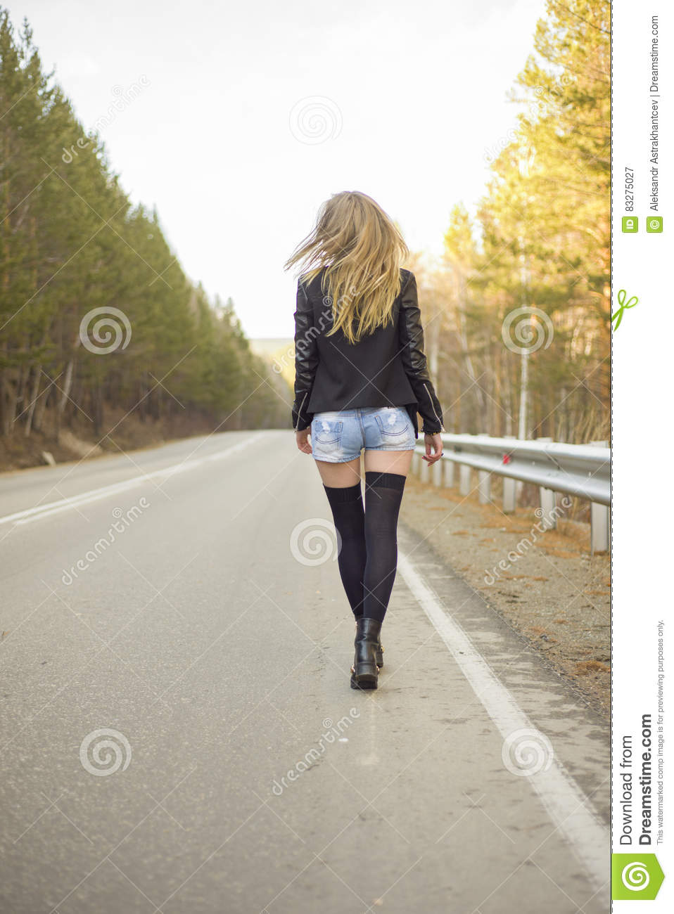 Young Woman Walking On Road In Forest Stock Image - Image