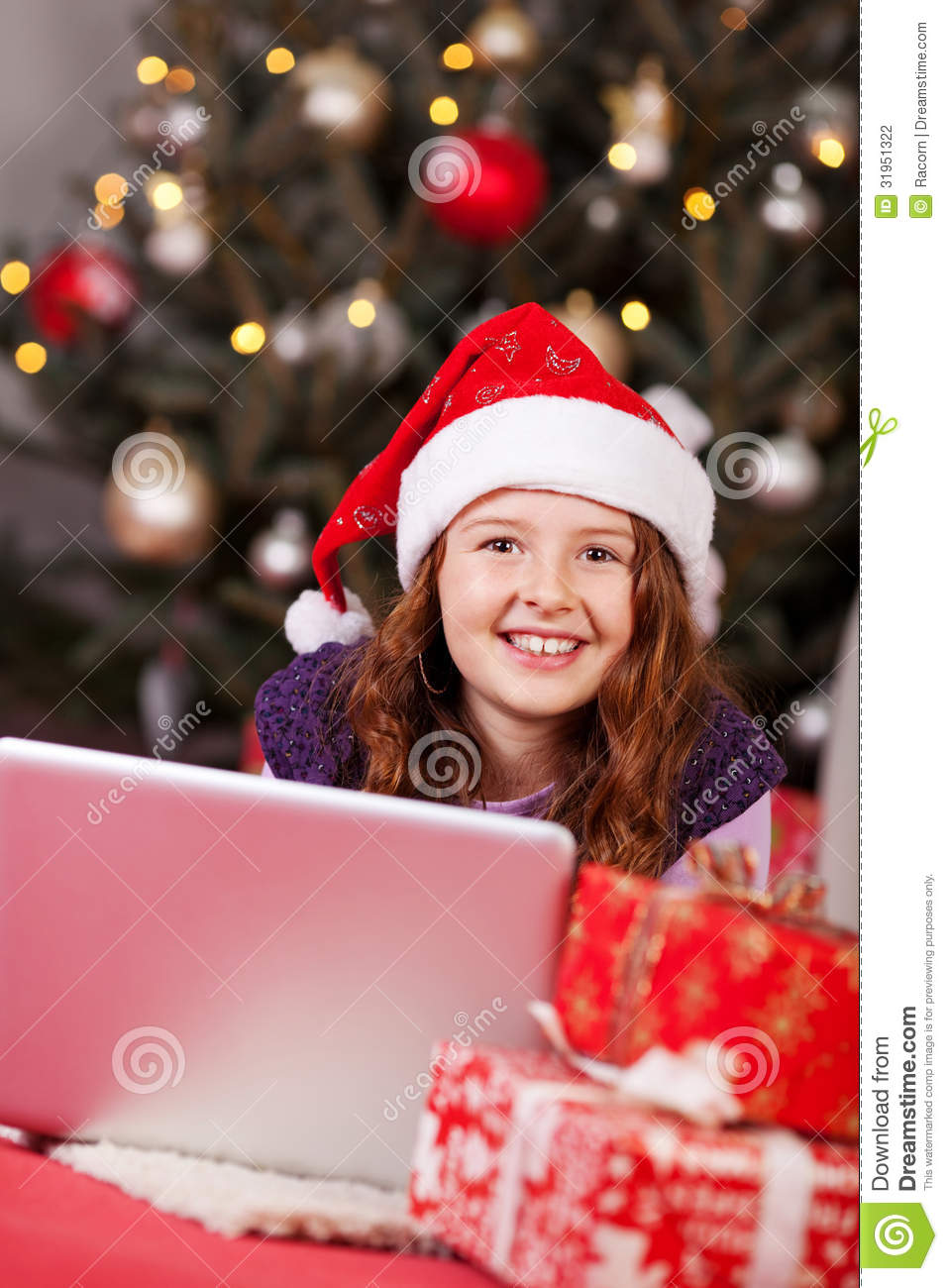 Beautiful young girl wearing a red santa hat stock photography image