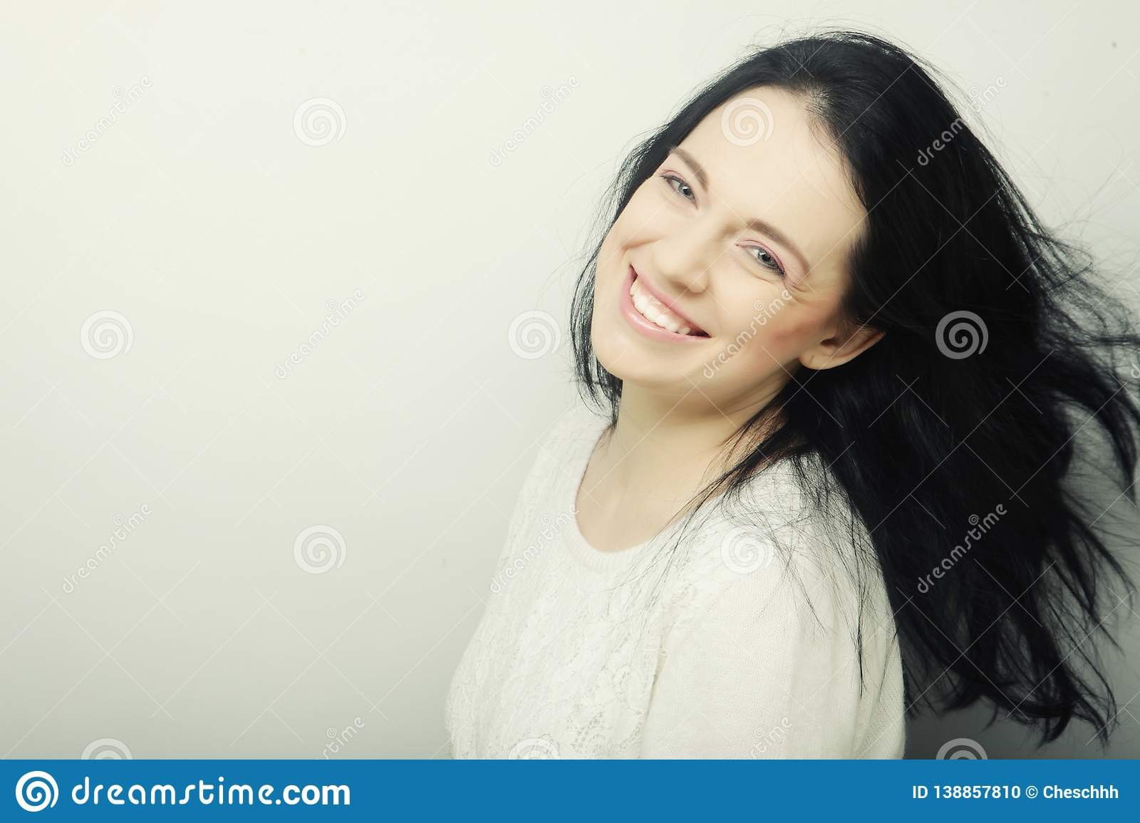 Beautiful young happy brunette woman.
