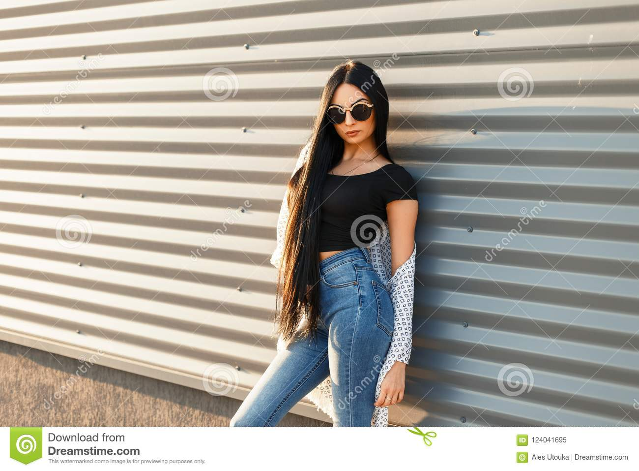 Beautiful young hipster woman in round sunglasses in trendy good