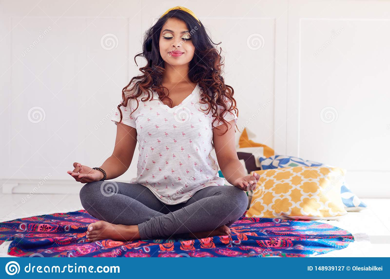 Beautiful Indian Woman Doing Yoga Exercises At Home Padmasana Or Lotus Pose Stock Image Image Of Meditate Hand 148939127