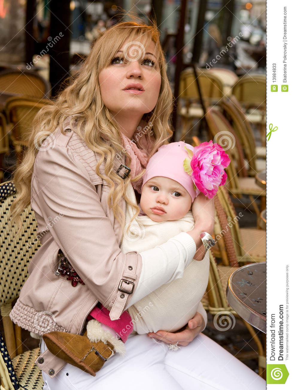 Beautiful young mother with her baby daughter