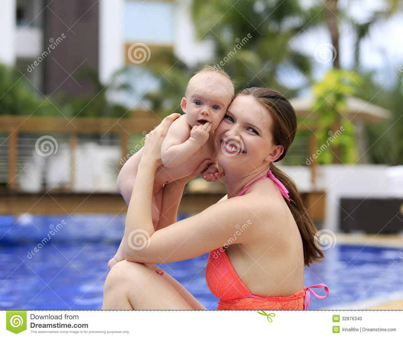 Beautiful young mother is holding baby girl outside near pool stock photo image 32876340 3 month old baby swimming pool