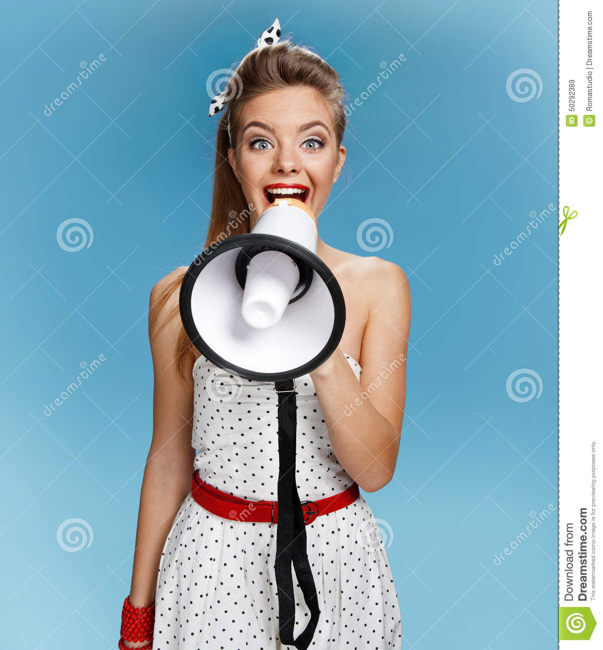 Beautiful young pin-up girl speak in megaphone, mouthpiece, speaking trumpet. Filmmaking or film production concept