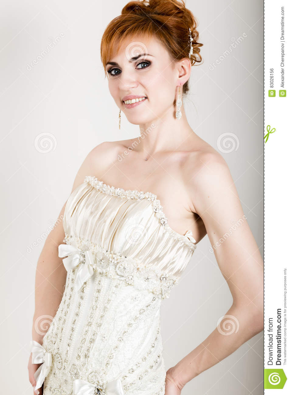 Beautiful young redhead bride wearing white wedding dress with download beautiful young redhead bride wearing white wedding dress with professional make up and hairstyle junglespirit Choice Image