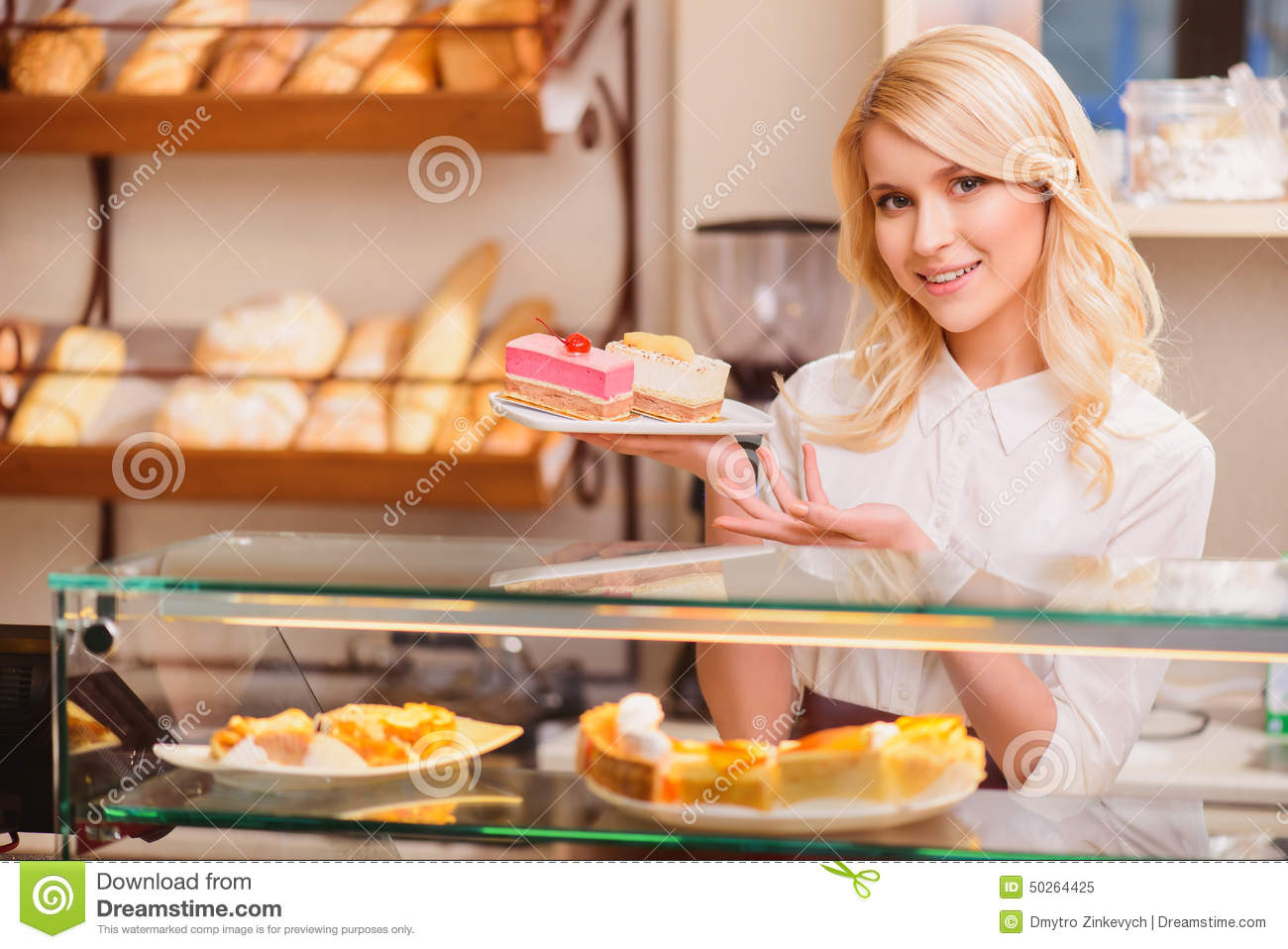Beautiful Young Saleswoman In A Bakery Stock Photo Image