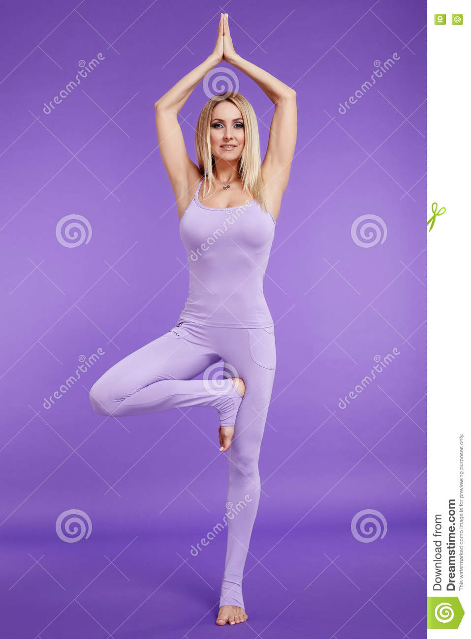 Beautiful young blond woman perfect athlete slim figure in gymnastics exercise stretching, trainer, fitness health wear sport