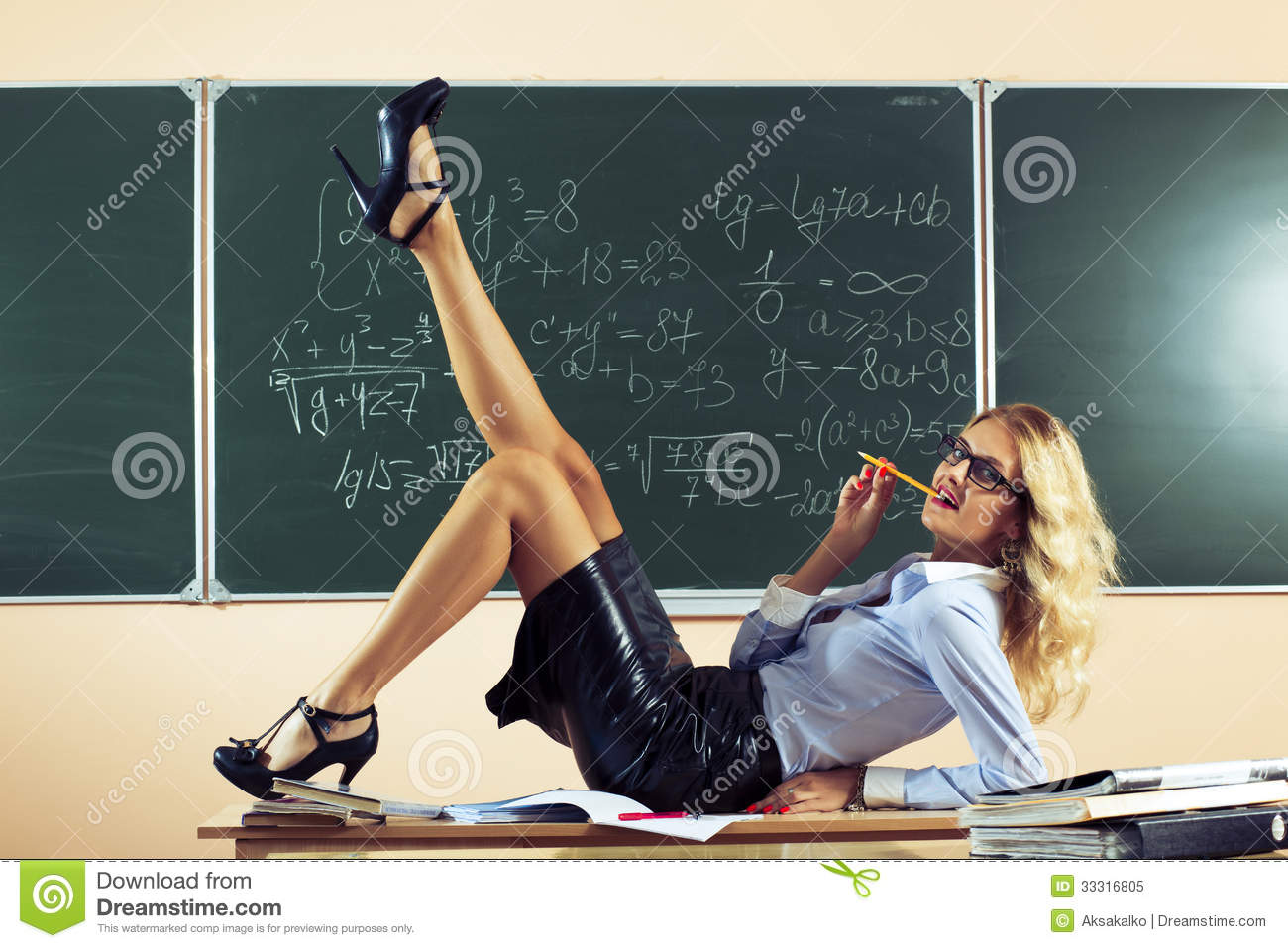 https://thumbs.dreamstime.com/z/beautiful-young-sexy-teacher-posing-table-33316805.jpg