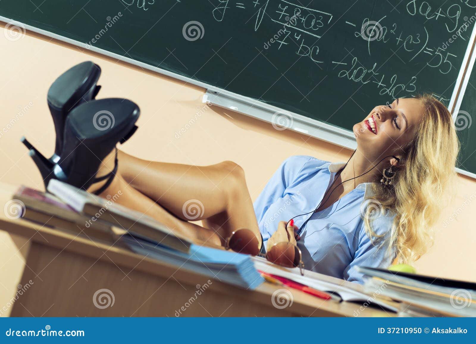 Beautiful Young Sexy Teacher Stock Photo - Image: 37210950: http://www.dreamstime.com/stock-photo-beautiful-young-sexy-teacher-resting-classes-image37210950