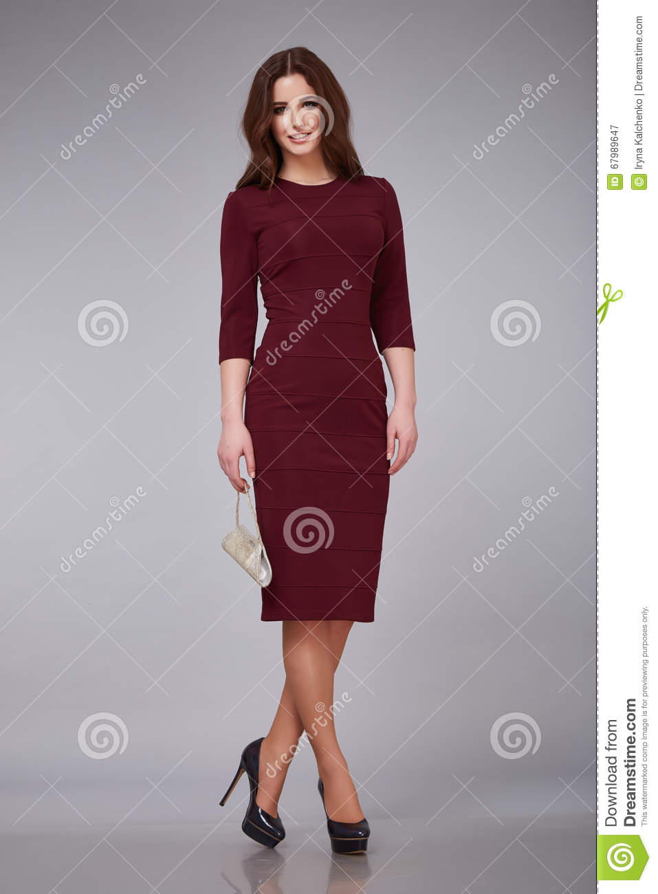 Beautiful young woman lady stylish elegant fashionable dress, makeup and hair style for the evening business meeting walk dat
