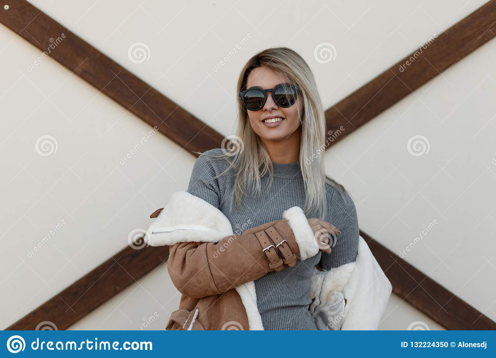 Beautiful young smiling girl with fashionable black sunglasses