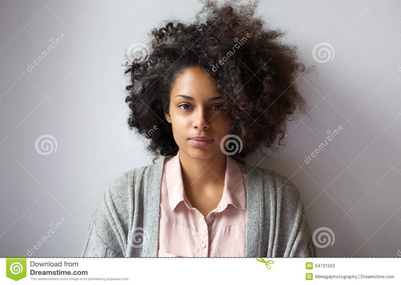 Beautiful afro woman training on weight machine royalty free stock photo - Coupe afro femme ...