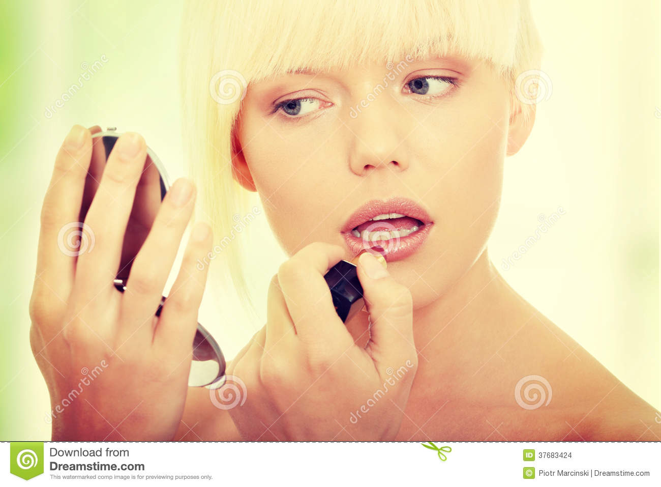 A Beautiful Young Woman Applying Her Make Up Stock Images