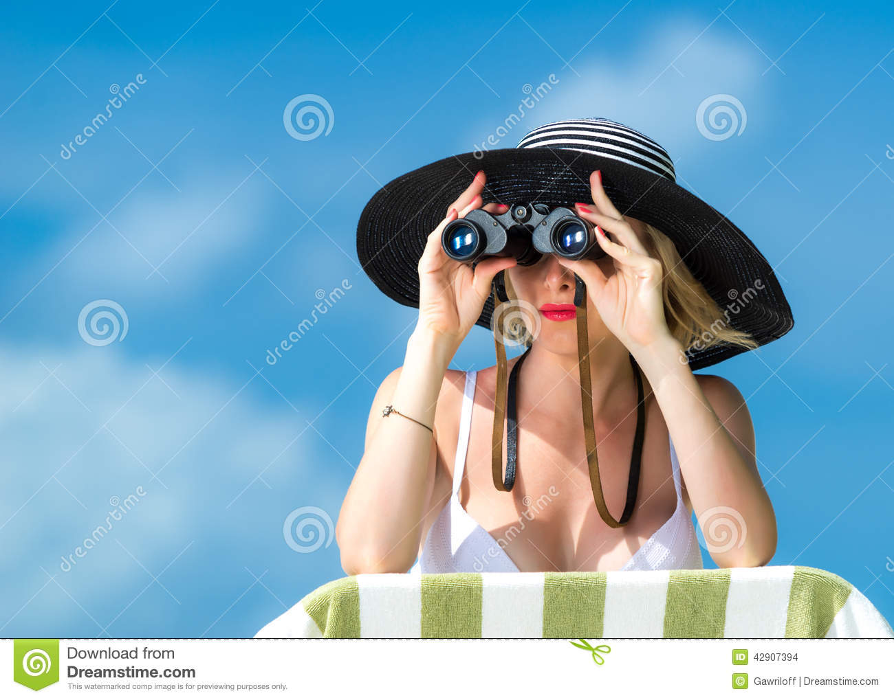 Bikini woman with binoculars