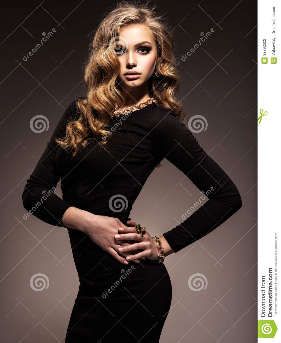 Beautiful woman in black bodycon dress with long curly hair