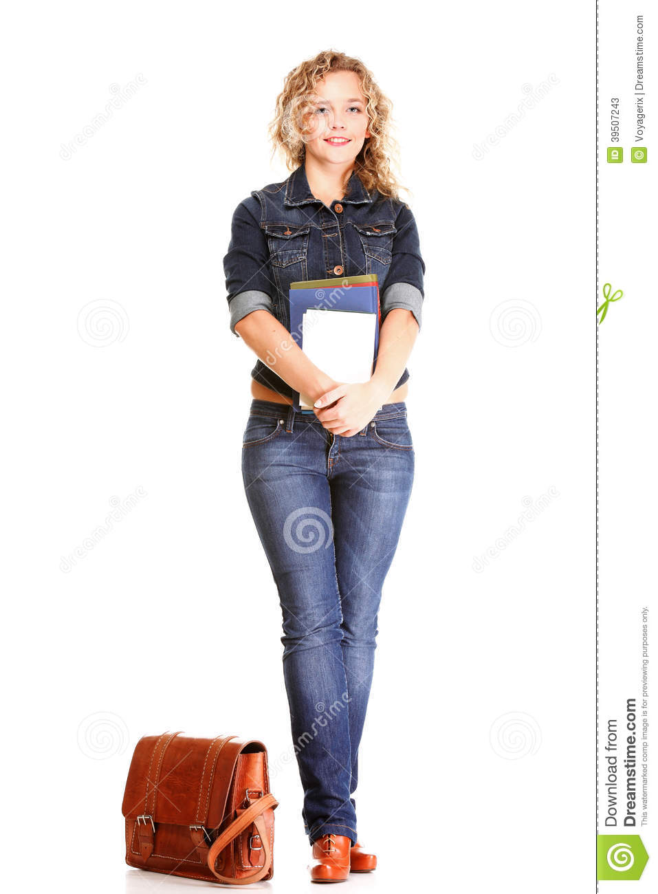 Beautiful young woman blonde standing full body in jeans isolate