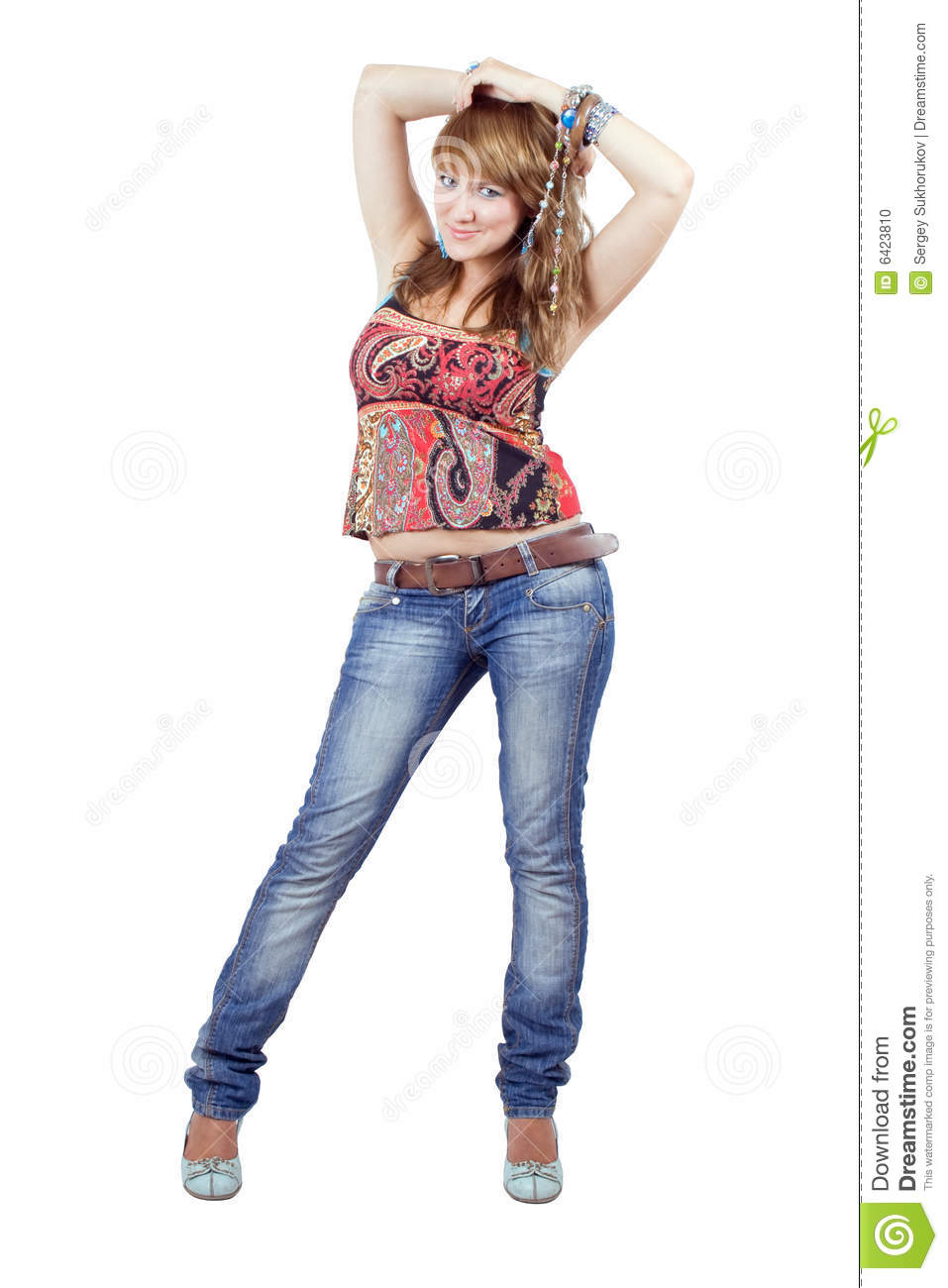 The beautiful young woman in blue jeans
