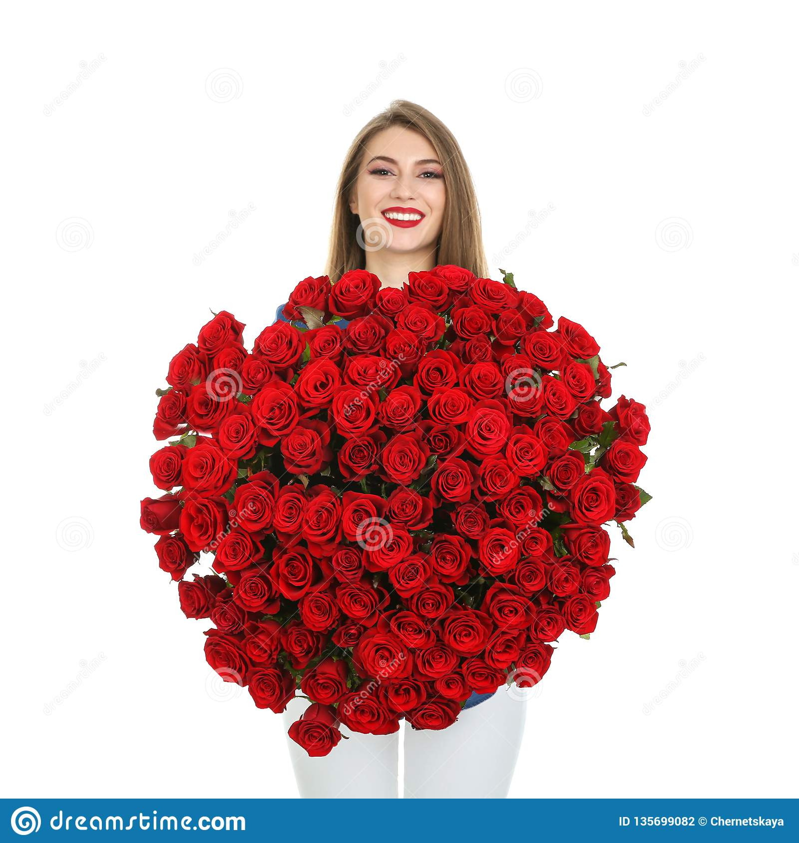 Beautiful young woman with bouquet of roses on white