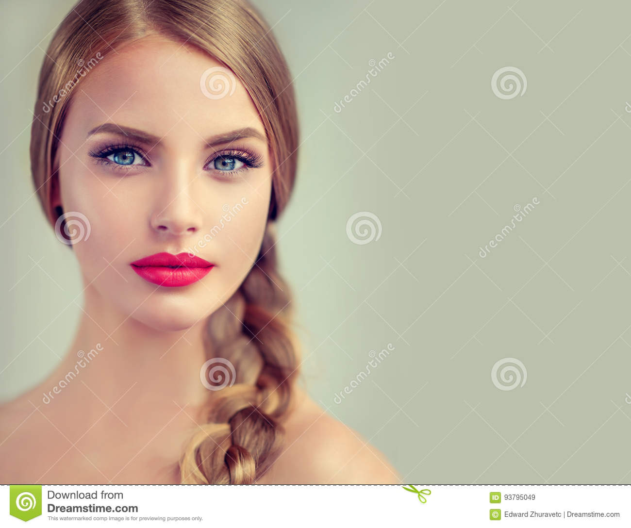 Beautiful young woman with braidpigtail and big earrings on her.