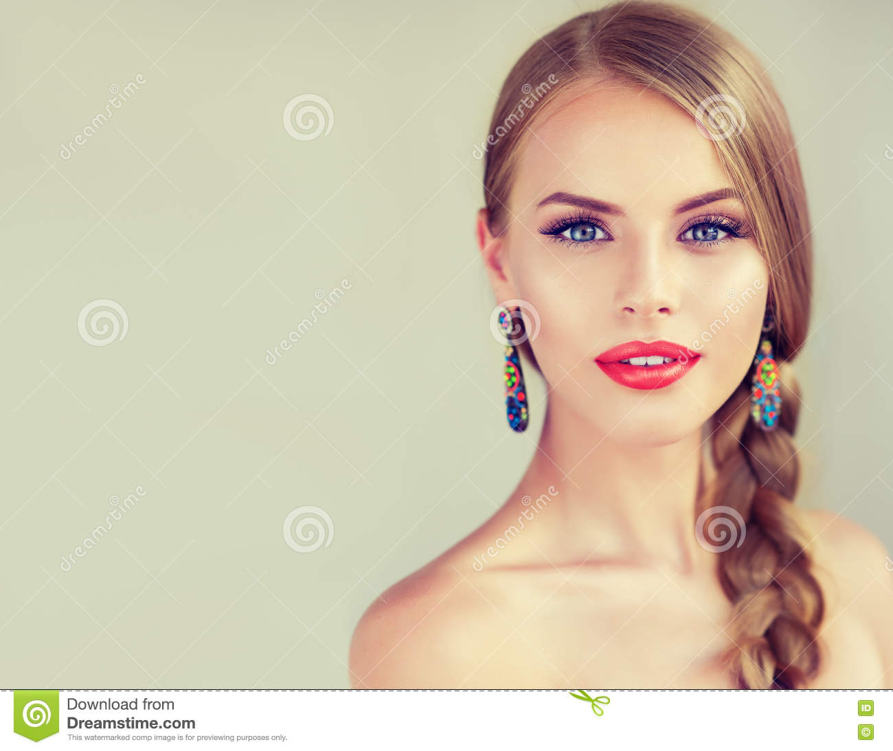 Beautiful young woman with braidpigtail.