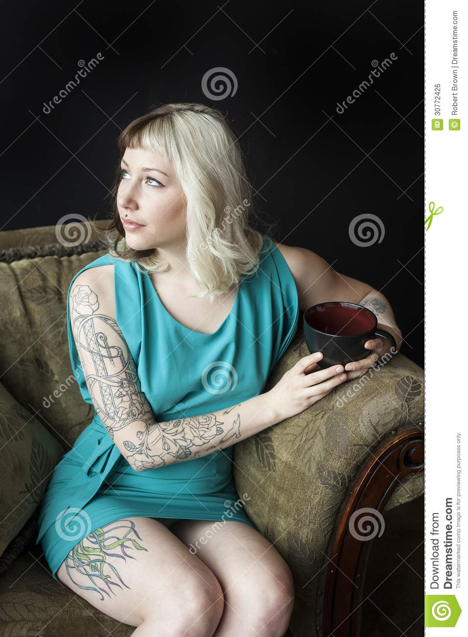 Beautiful Young Woman with Brown and Blond Hair Holding Black Co