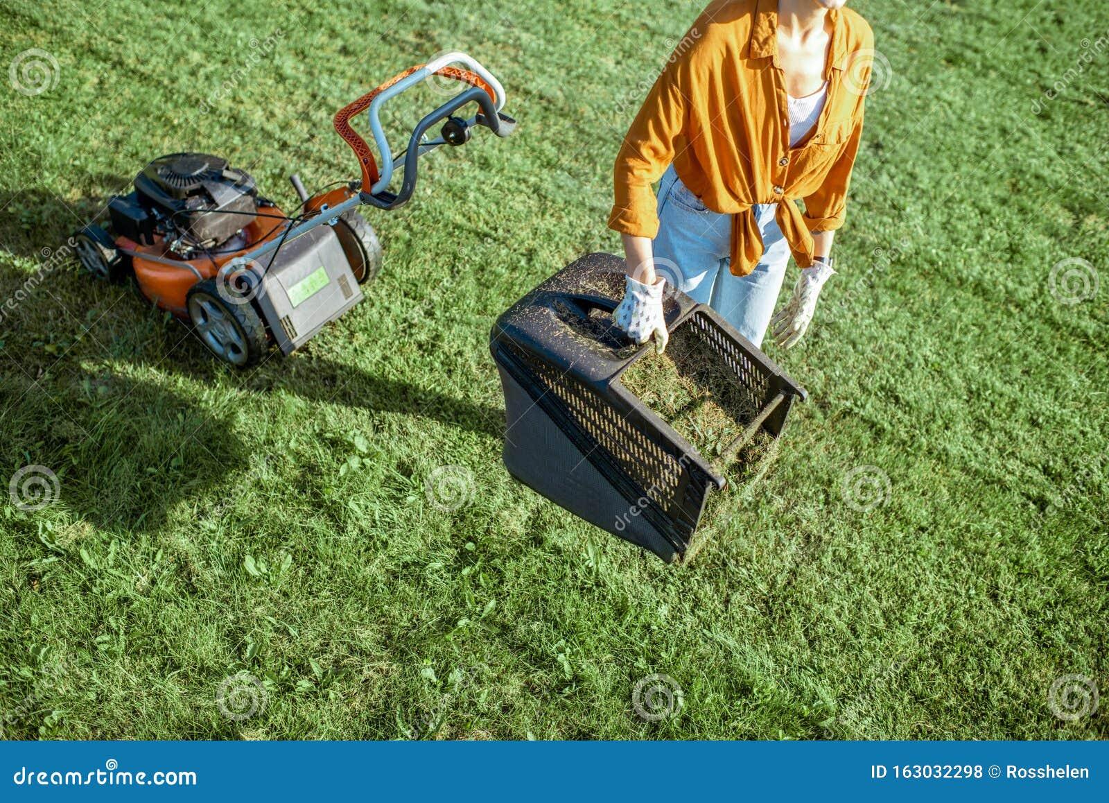 Young Woman Working In Garden Gardening Trimming Grass