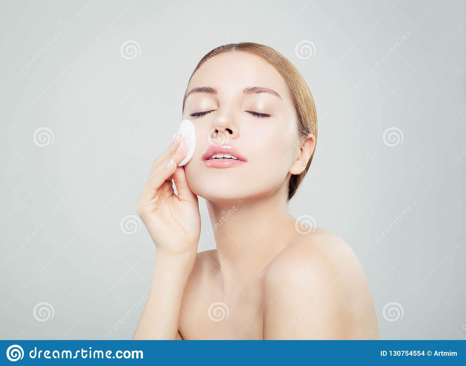 Beautiful young woman with clean cotton pads. Facial treatment